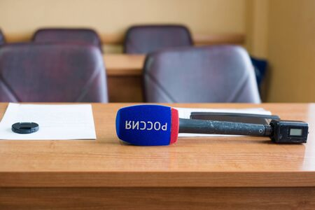 correspondent: Russian TV channel microphone on the table Stock Photo