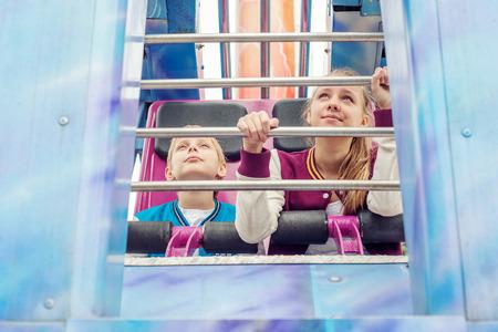 10 12: Teens Ride on the Carousel Stock Photo