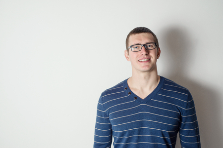 v neck: Portrait of a cheerful young man wearing glasses