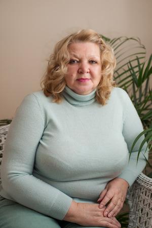 65 years old: Portrait of an elderly woman blonde