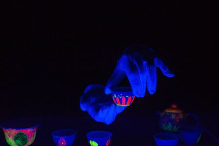 ultraviolet: Tea ceremony in ultraviolet light Stock Photo