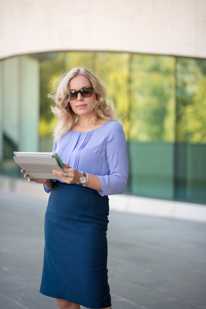 Woman blonde with digital tablet