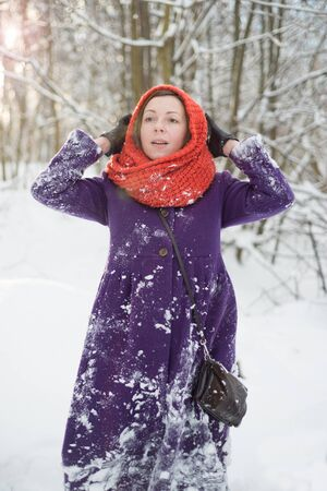 Natural portrait of a woman in a winter forest