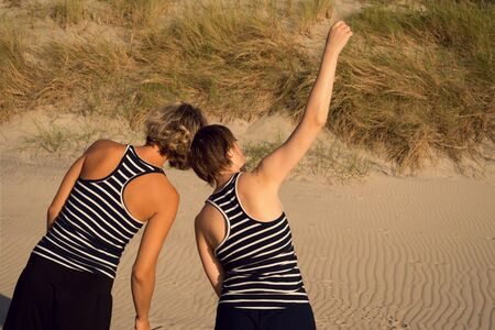 Two women dance a contact improvisation in nature Stock Photo