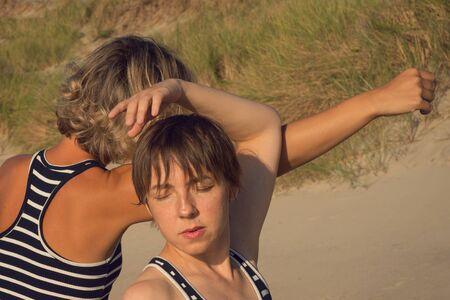 Two women dance a contact improvisation in nature Archivio Fotografico