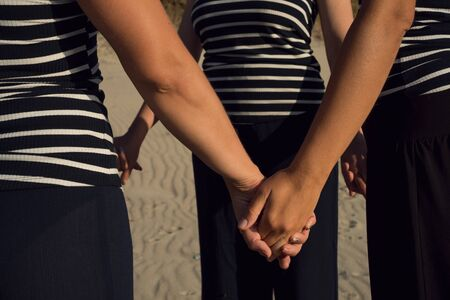 People stand together and hold hands Archivio Fotografico