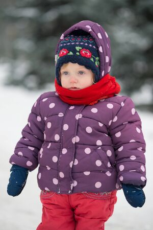 Little girl in winter clothes Stock Photo
