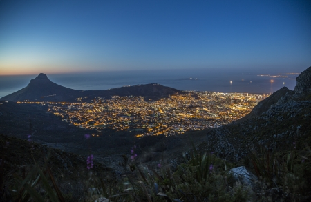 cape town: The city bowl of Cape Town, Robben Island  where Nelson Mandela served time  and Lion s Head at night, just after the sun set