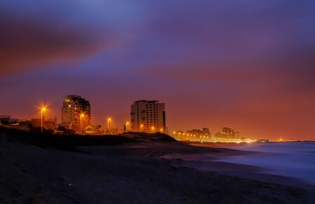 City scape by the beach at night  photo