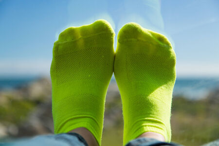 Lime green socks and her feet on the car