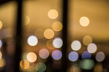 Colourful round lights in the background as though you are looking through a glass window or sliding door