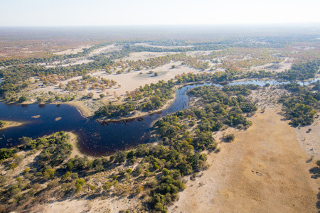 An aerial landscape of the magnificent Okavango Delta twisting and turning as it flows and splits.