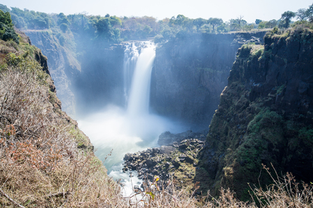 A landscape image of Devils Cataract at Victoria Falls. A slow shutter speed makes for movement in the water.