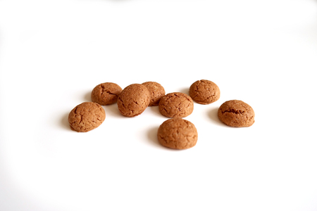Dutch cookie (ginger nuts) for holiday Sinterklaas (St. Nicholas), on a white background.