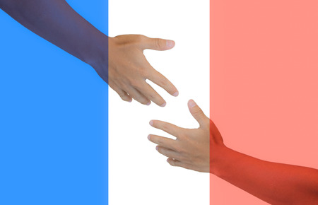 Hands reaching for peace and pray paris
