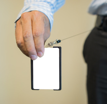 Close up of businessperson hands holding security keycard to open secure door