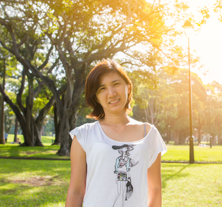 Girl smiling relaxing in the park on a sunny day Stok Fotoğraf