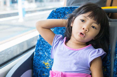 Young kid enjoy relax sitting on the train Stok Fotoğraf