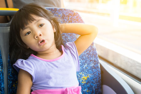 Young kid enjoy relax sitting on the train on a sunny day Stok Fotoğraf