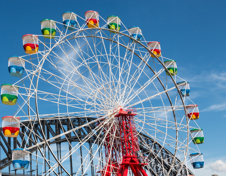 Ferris wheel with blue sky and harbour bridge on a sunny day