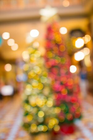 Lens Blur Christmas tree with many decoration lights background
