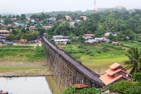Old Wooden Bridge Crossing River