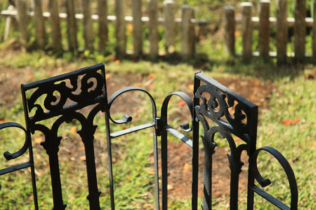 The iron gate between the house and the garden. Stock Photo