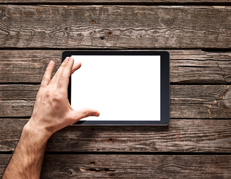 Man use a spread gesture on touch screen of digital tablet. Clipping path included. Banque d'images