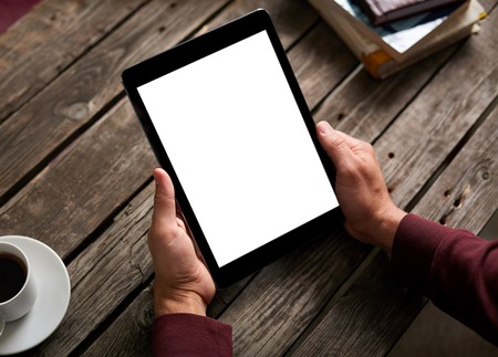 Man shows screen of digital tablet in his hands. Clipping path included.