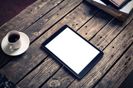 Digital tablet computer with isolated screen on wooden table with cup of coffee Stock fotó