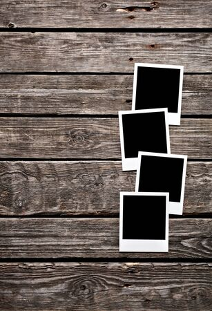 old photo: Blank photo frames on old wooden background.