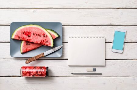 old notebook: Paper notebook with template of smartphone, knife and slices of watermelone. Clipping path.