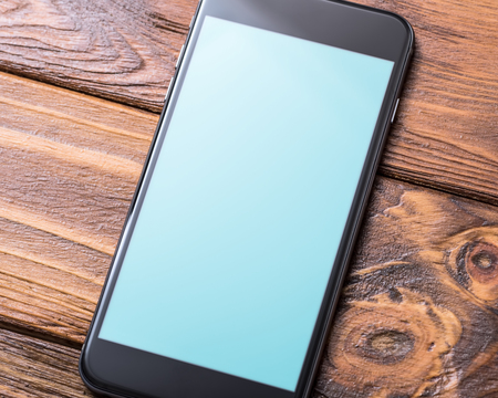 cell phone: Black smartphone mock-up on table close-up. Clipping path Stock Photo