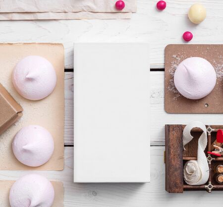 substrate: White box mockup between different sweets on the table and figures