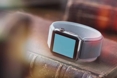 Mockup of smart-watch on the book. Clipping path