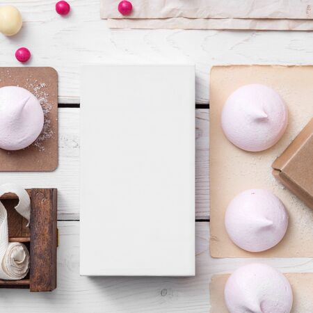 substrate: White box mockup between sweets on the table