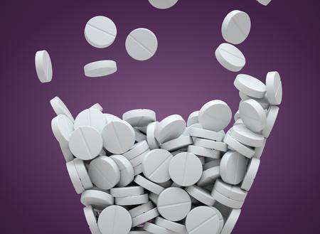 White pills falling Stock Photo