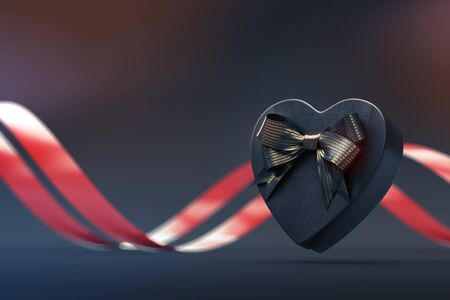 Heart shaped gift box with bow on black