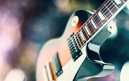 6 string guitar close up shot. Over abstract background with blured lights. 3D render. Stock Photo
