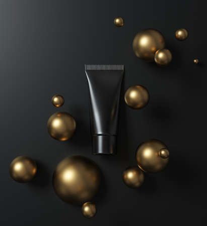 Black cosmetic product mockup - cream tube lies on black surface among gold spheres 스톡 콘텐츠