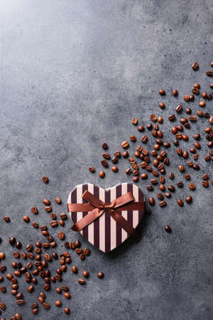 Heart shaped gift box with coffee beans around