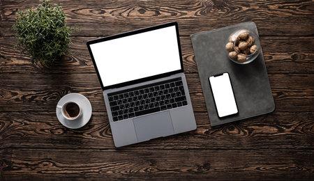 Mockup of laptop and smartphone on a desktop