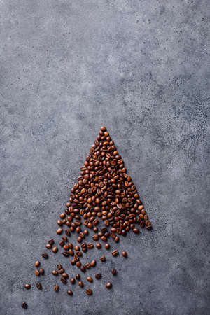Coffee beans in a form of an arrow Фото со стока