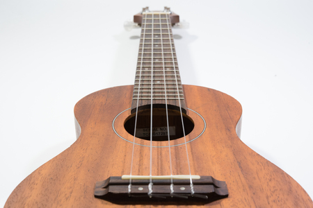 Classic wooden ukulele with four nylon string this is a wonderful musical instrument unplug