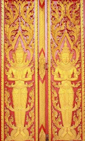 Wooden doors carved in gold and red, with the angels.