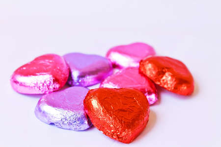 Sweet shot sweet chocolate wrapped in foil paper provided a heart for those we love. photo