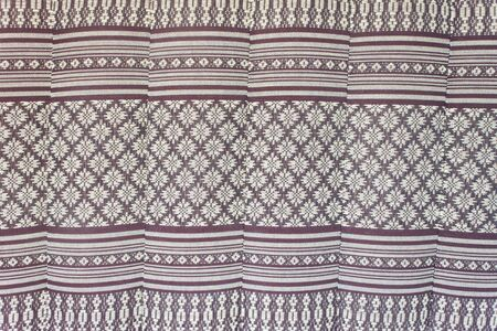 Thai cotton is woven by hand in the local community, which has a different pattern photo