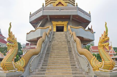 Golden dragon in front of the pagoda in Udontrani Thailand  photo