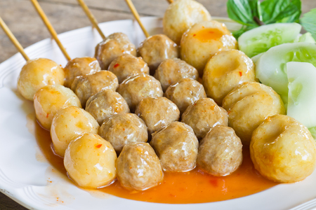 Grilled meat ball with sweet spicy sauce photo