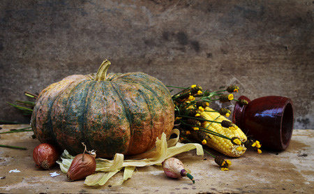Fruits and vegetables with pumpkins in vintage still life photo
